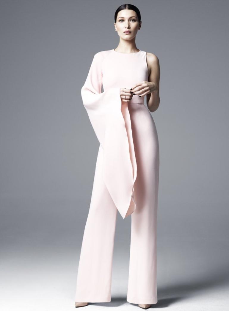 Embracing an asymmetrical silhouette, Bella Hadid models a Misha Gold Yari jumpsuit