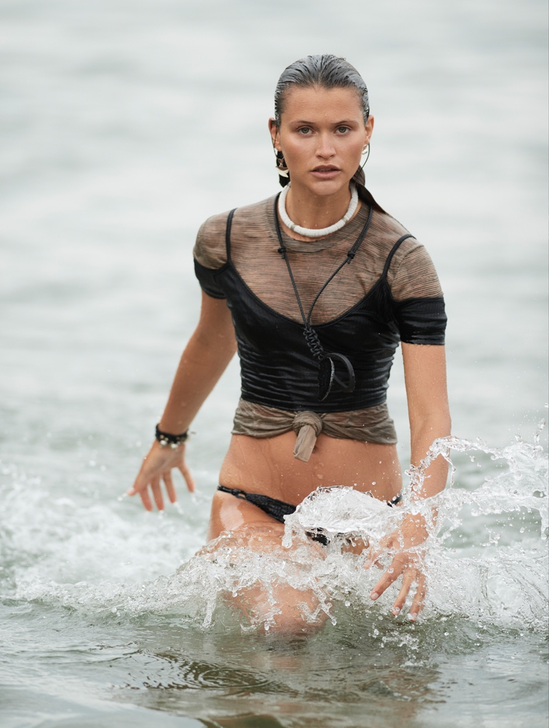 Chloe Lacreaux models Neon Hart black top over COS t-shirt and Frankies Bikinis bikini briefs