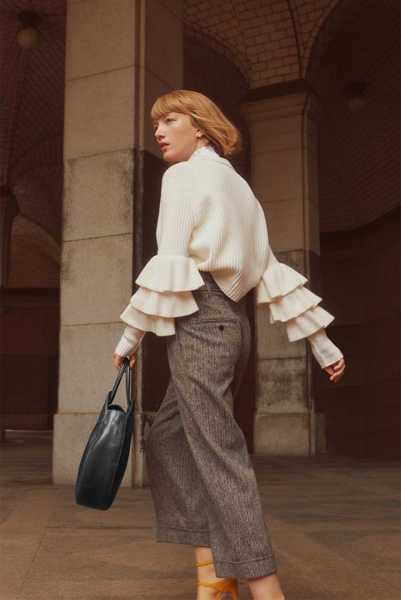 Lou wears Club Monaco Asal Sweater, Olivianne Pant and Meradyth Suede Pump