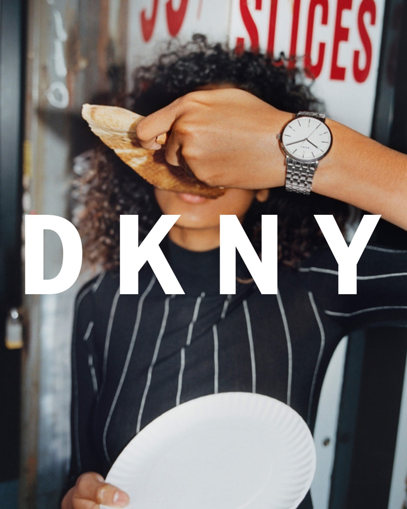 Photographed in New York City, Imaan Hammam poses with the famous large pizza slice