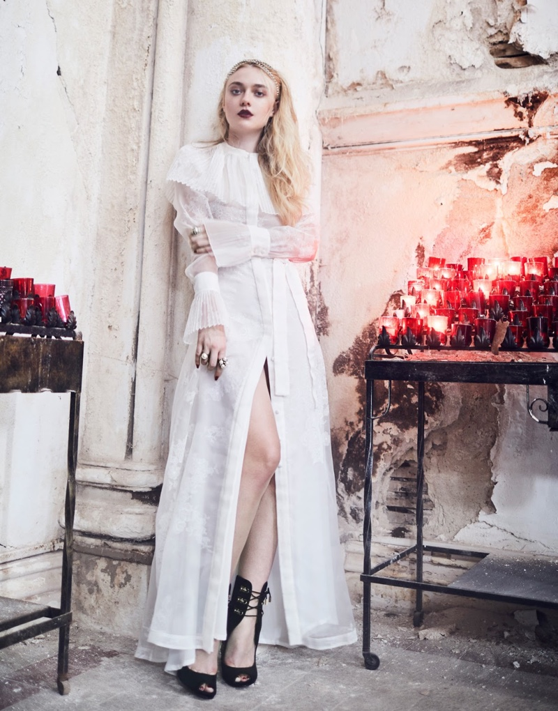 Looking angelic in white, Dakota Fanning poses in Merchant Archive with strappy Paul Andrew sandals