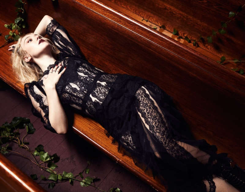 Lounging in the pews, Dakota Fanning gets gothic in Dolce & Gabbana dress with Miu Miu boots
