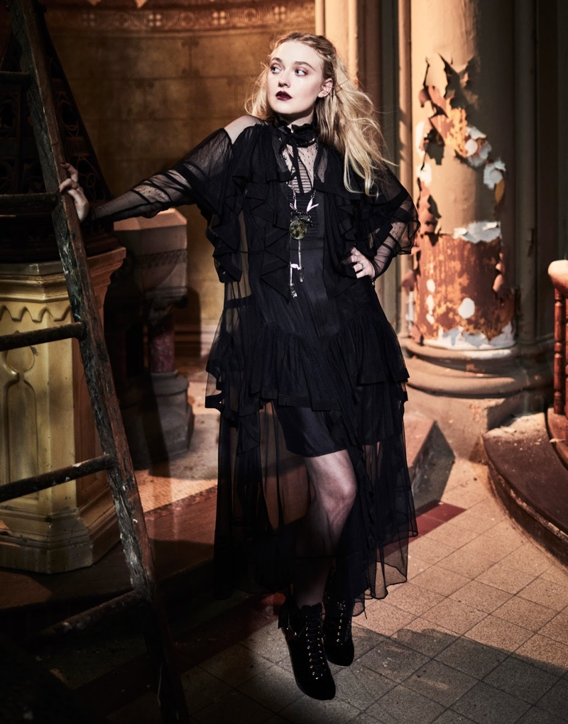 Clad in all black, Dakota Fanning wears Preen by Thornton Bregazzi dress with Miu Miu boots