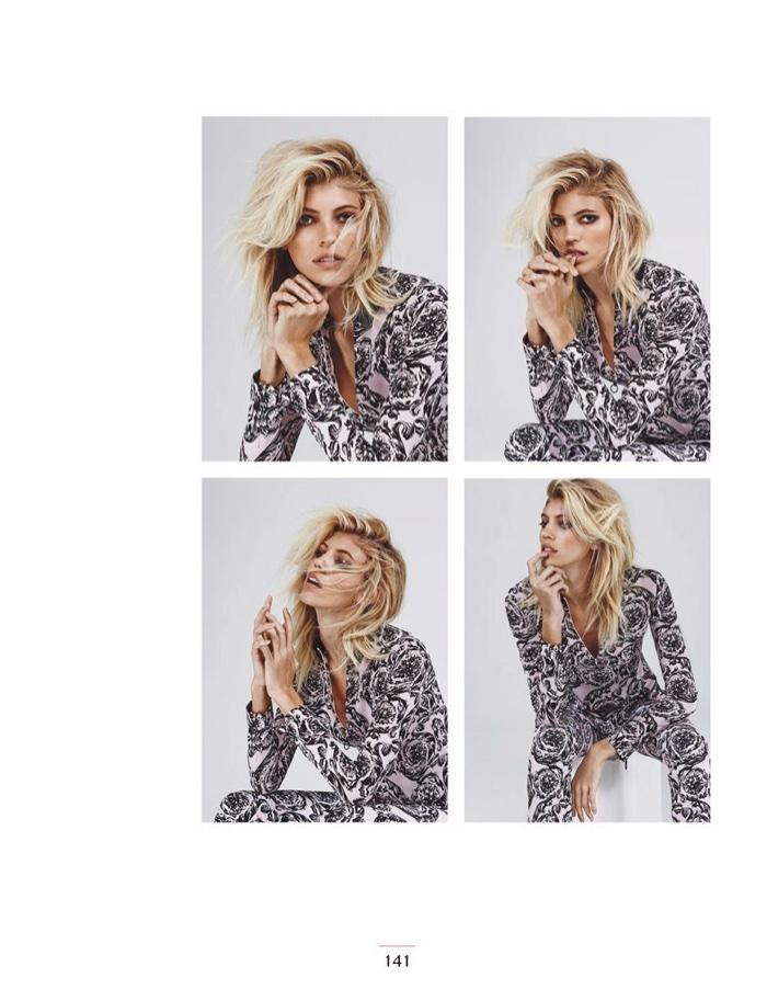 Captured in the studio, Devon Windsor wears Versace shirt and pants