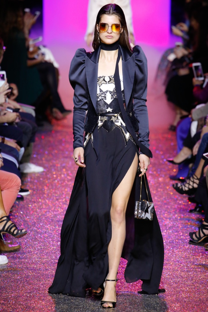 Elie Saab Spring 2017: Julia van Os walks the runway in jacket with mutton sleeves over gown with embroidered bodice