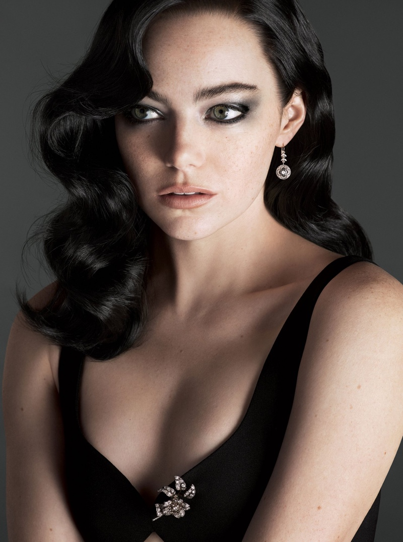 Actress Emma Stone serves brunette bombshell with her hair in retro waves