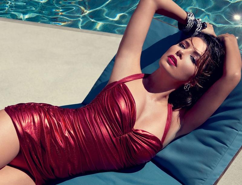 Posing poolside, Eva Longoria glitters in red Norma Kamali swimsuit