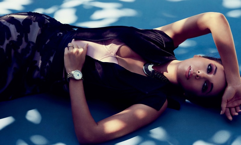 Eva Longoria poses in Roberto Cavalli suede vest, Fleur du Mal bodysuit and The Limited skirt