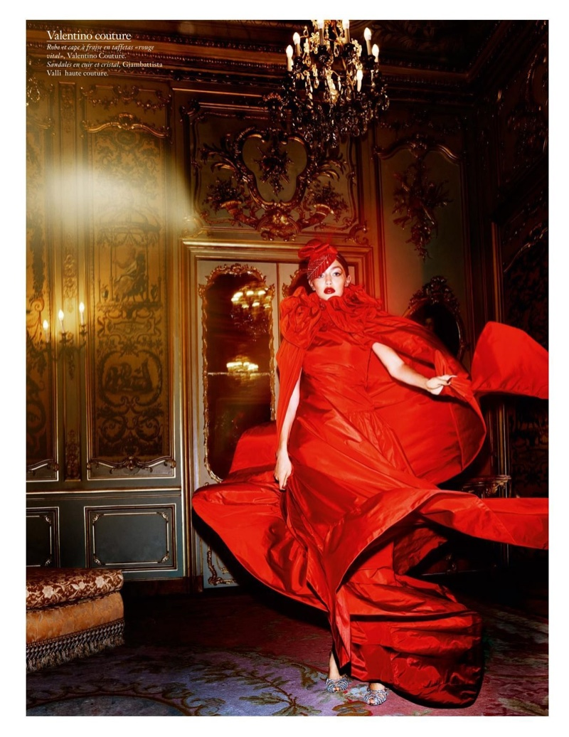 Looking seductive in red, Gigi Hadid models Valentino Haute Couture gown and cape