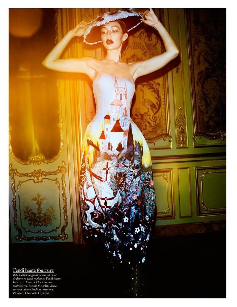 Wearing a dress with a painterly scene, Gigi Hadid models Fendi Haute Fourrure