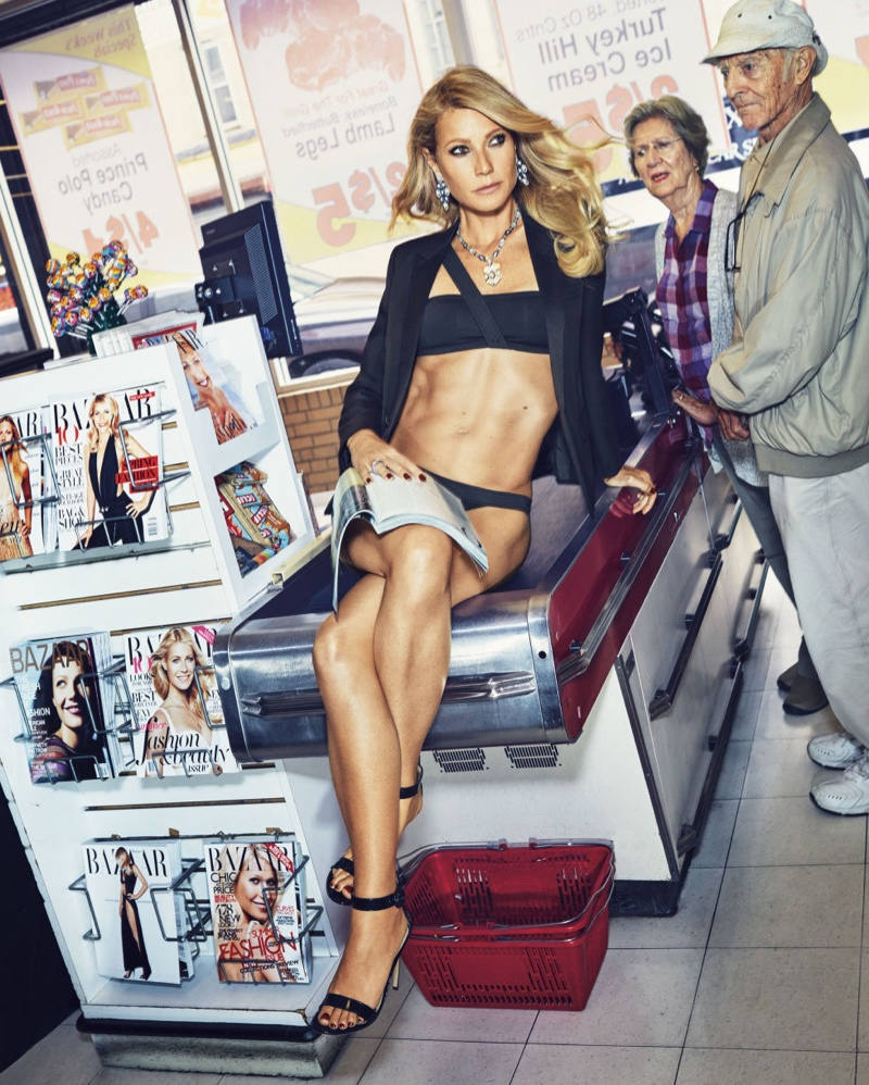 Posing at a checkout line, Gwyneth Paltrow wears Saint Laurent jacket, Eres bikini and Gianvito Rossi heels