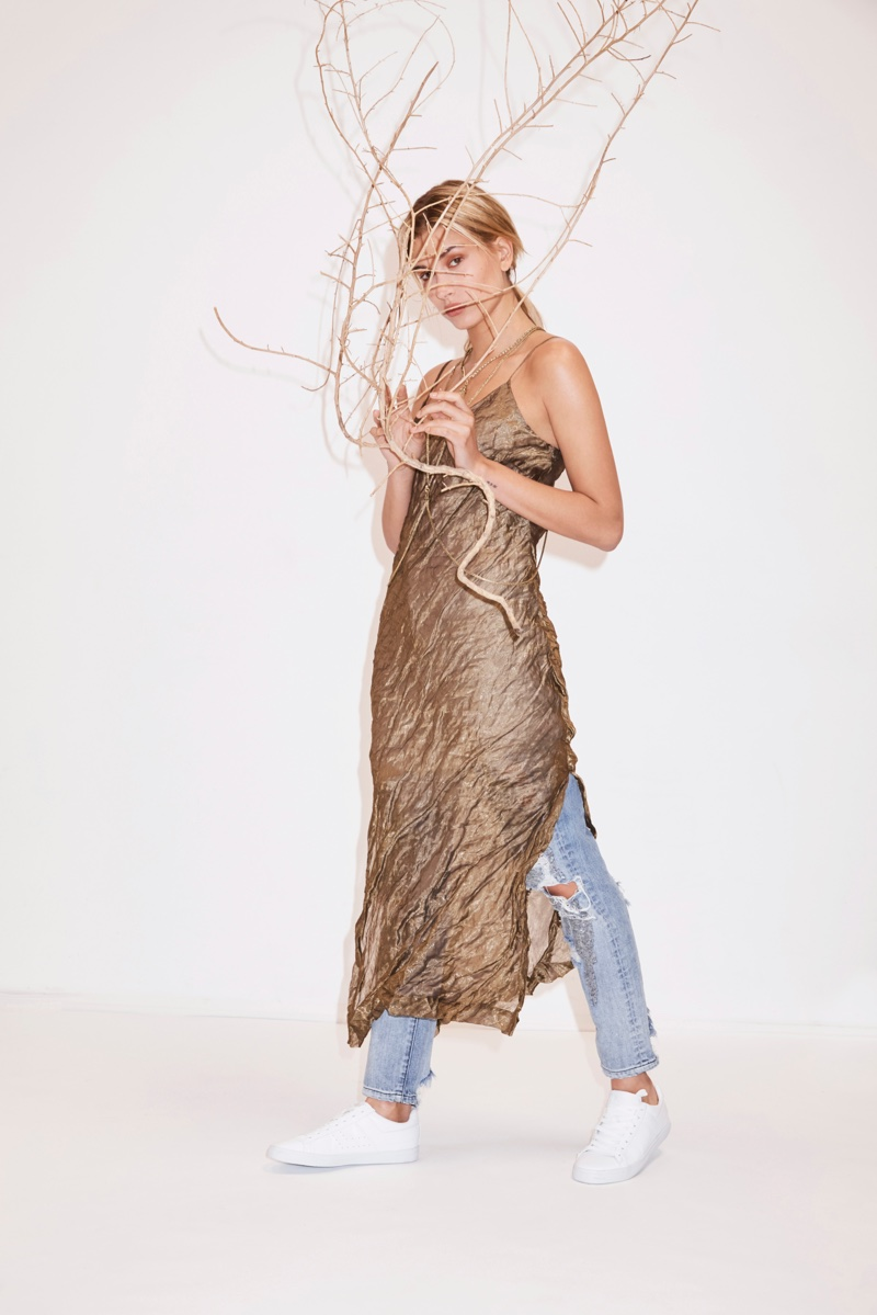 Posing in a Sass & Bide crinkled slip dress and ripped denim, Hailey Baldwin hides behind a branch