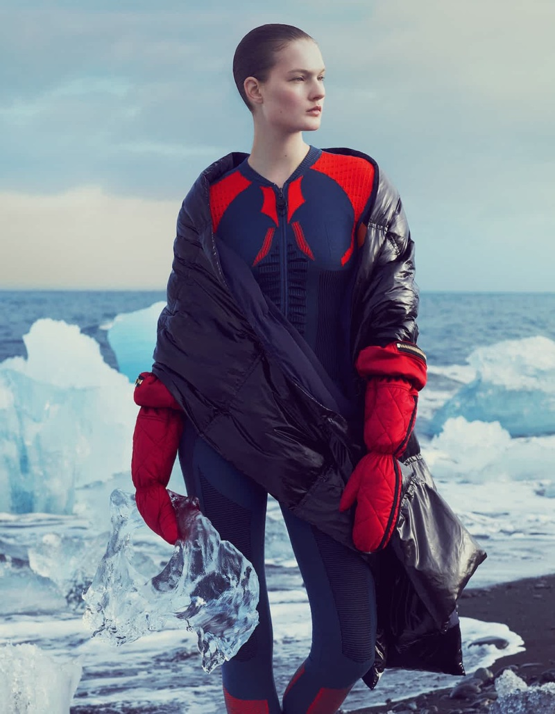 Looking to the distance, Kirsi Pyrhonen poses in DKNY scard, Louis Vuitton jumpsuit and Astrid Andersen gloves