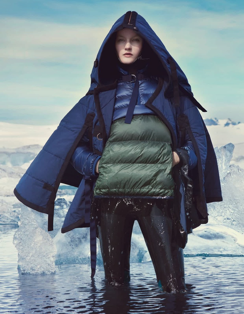 The model poses in puffer jackets for the fashion spread