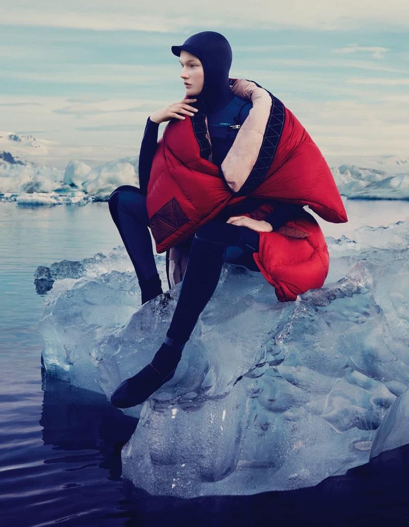 Sitting on a glacier, Kirsi Pyrhonen models Anne Sofie Madsen nylon coat