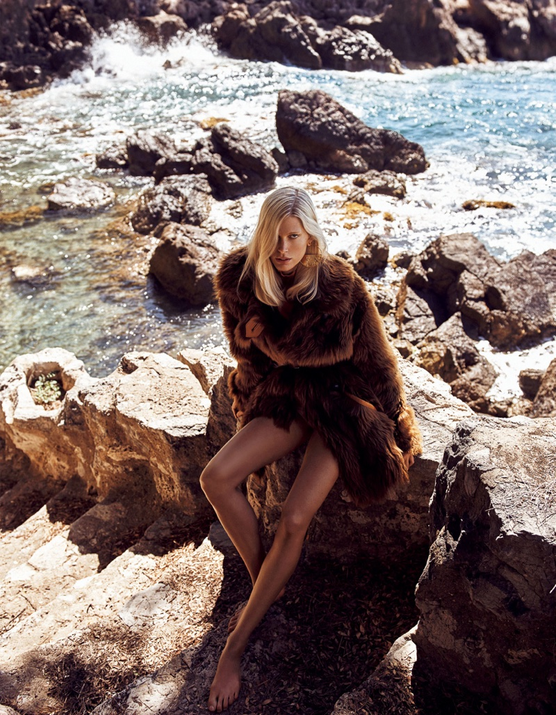 Flaunting her legs, Iselin Steiro wears a shaggy fur jacket from Coach