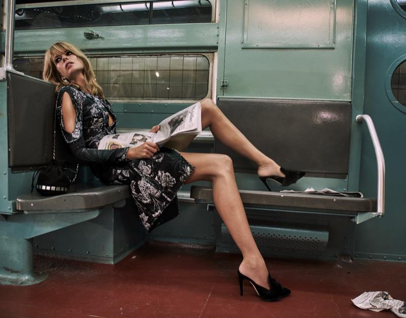 Reading a newspaper, the model wears an Erdem dress with mule heels from Sanayi 313