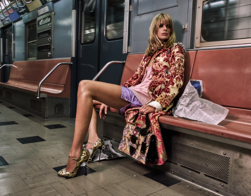 Posing on the subway, Julia Stegner models Miu Miu brocade coat, cardigan, shorts and pumps