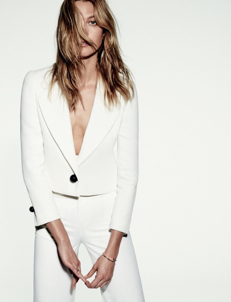Karlie Kloss suits up in white pantsuit
