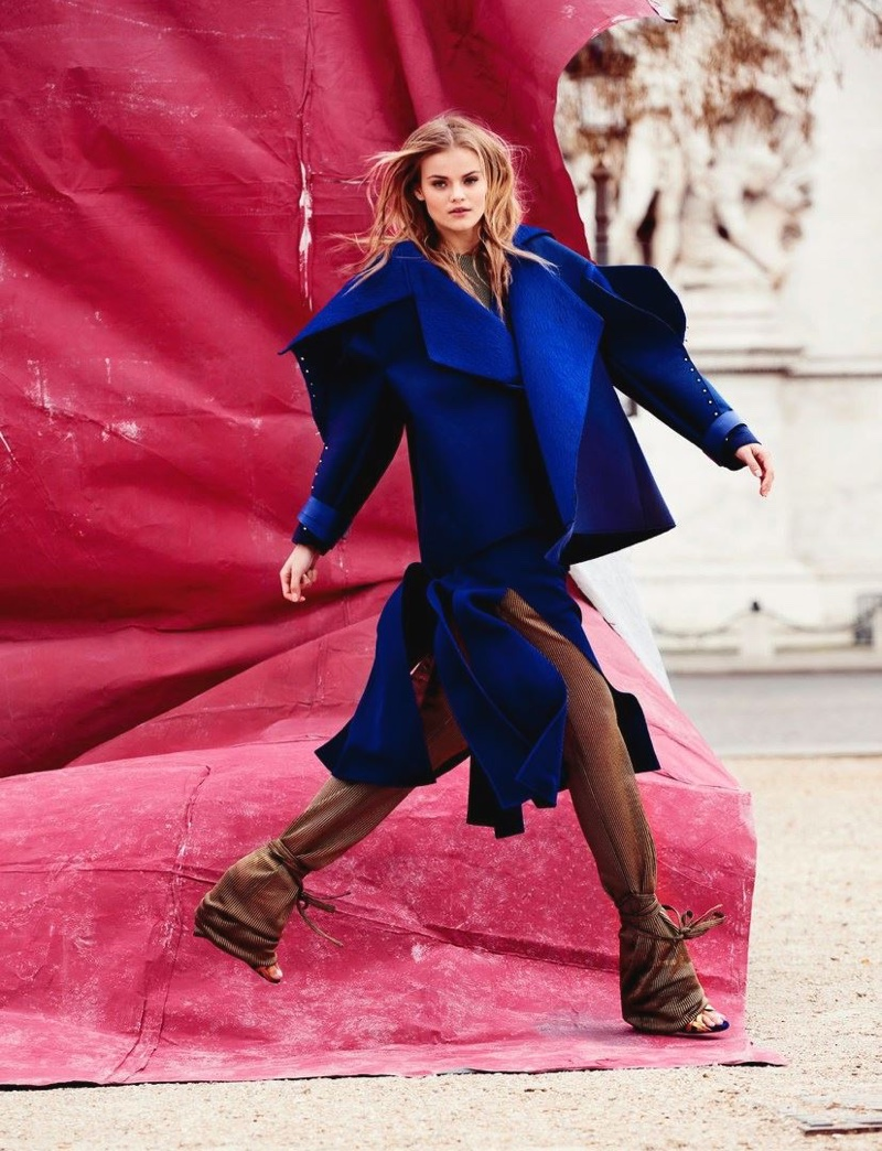 Kate Grigorieva models boxy blue coat over sheer pants