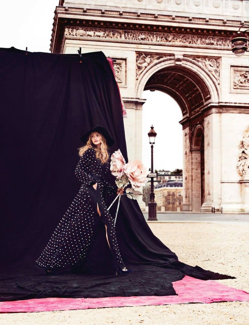 With a bouquet of flowers in hand, Kate Grigorieva wears Elie Saab dress