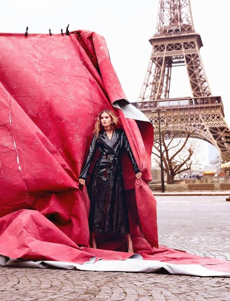 Kate Grigorieva models black lacquered trench coat