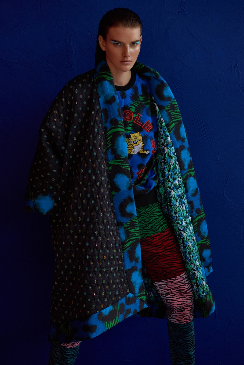 Model Dorota Kullova wears a sweater, coat and skirt from the Kenzo x H&M collaboration
