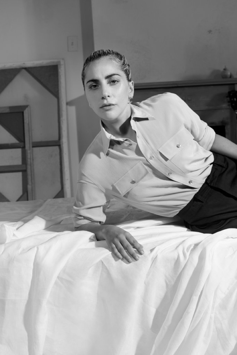 Photographed in black and white, Lady Gaga wears Ralph Lauren Collection shirt and black pants