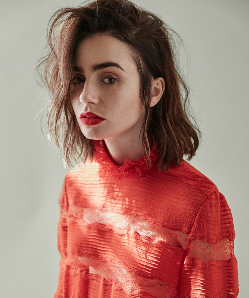 Actress Lily Collins wears Isabel Marant red top with matching red lipstick