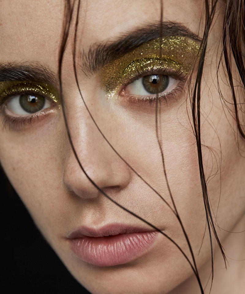 Wearing a wet hairstyle, Lily Collins poses in gold glittery eyeshadow