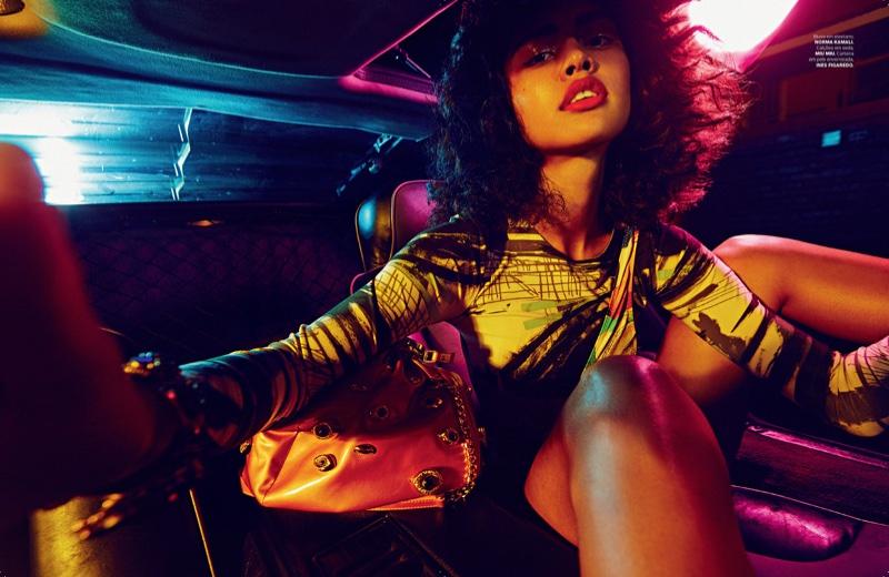 Sitting in the back of a car, Luz Pavon models Norma kamali blouse with Miu Miu handbag