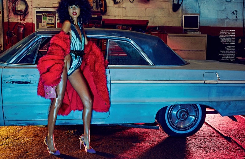 Luz Pavon strikes a pose in Norma Kamali swimsuit and vintage red fur jacket