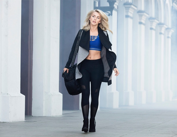 Julianne Hough is captured on the go as she models a sports bra, leggings, and a Mynx Yoga wrap from her MPG by Julianne Hough Collection.