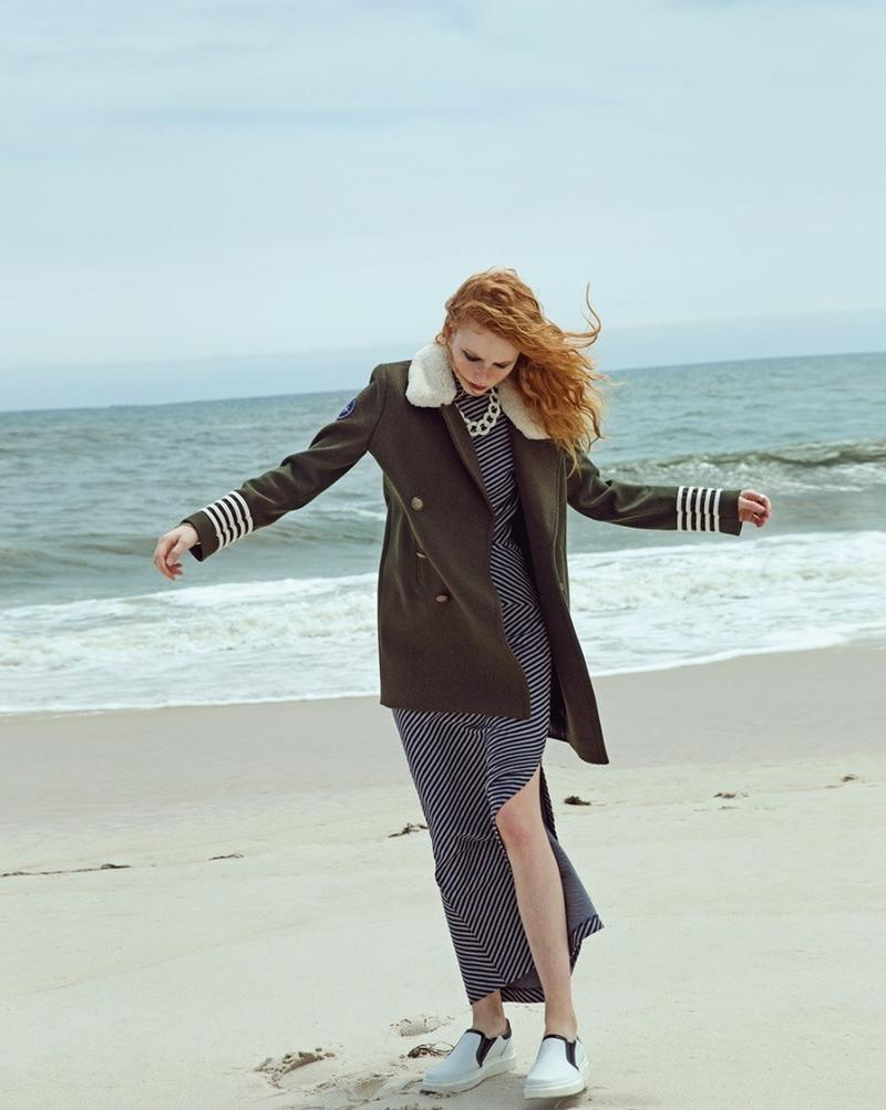 Embracing the breeze, Madison wears military peacoat, striped dress and white slip-on sneakers from Gigi Hadid x Tommy Hilfiger