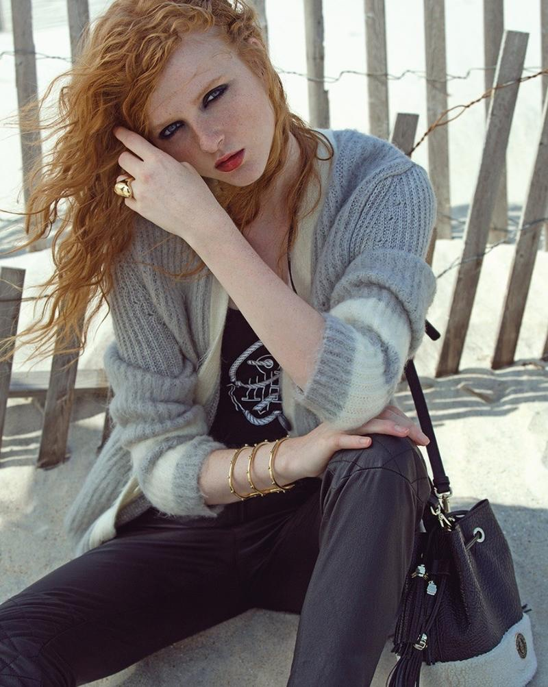 The redhead model wears Gigi Hadid x Tommy Hilfiger cardigan sweater, top and jeans