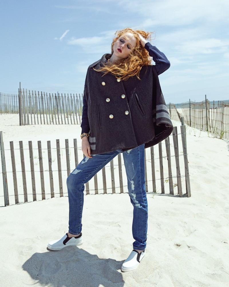 Madison Stubbington models Gigi Hadid x Tommy Hilfiger cape and jeans