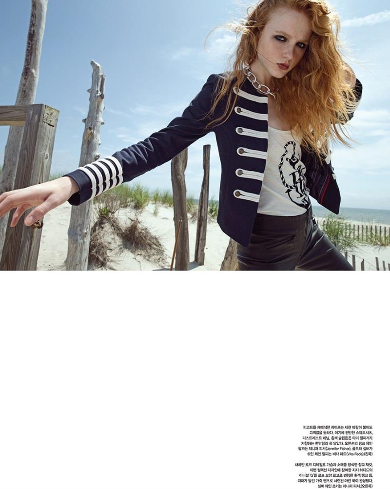 Embracing a nautical moment, Madison Stubbington wears military coat, tank top and pants from Gigi Hadid x Tommy Hilfiger