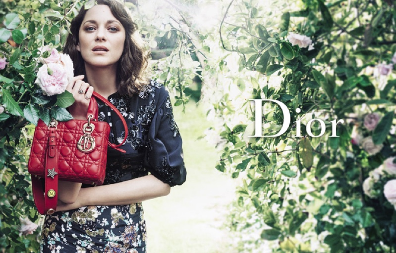 Marion Cotillard poses in a luxe garden for Lady Dior's resort 2017 advertising campaign