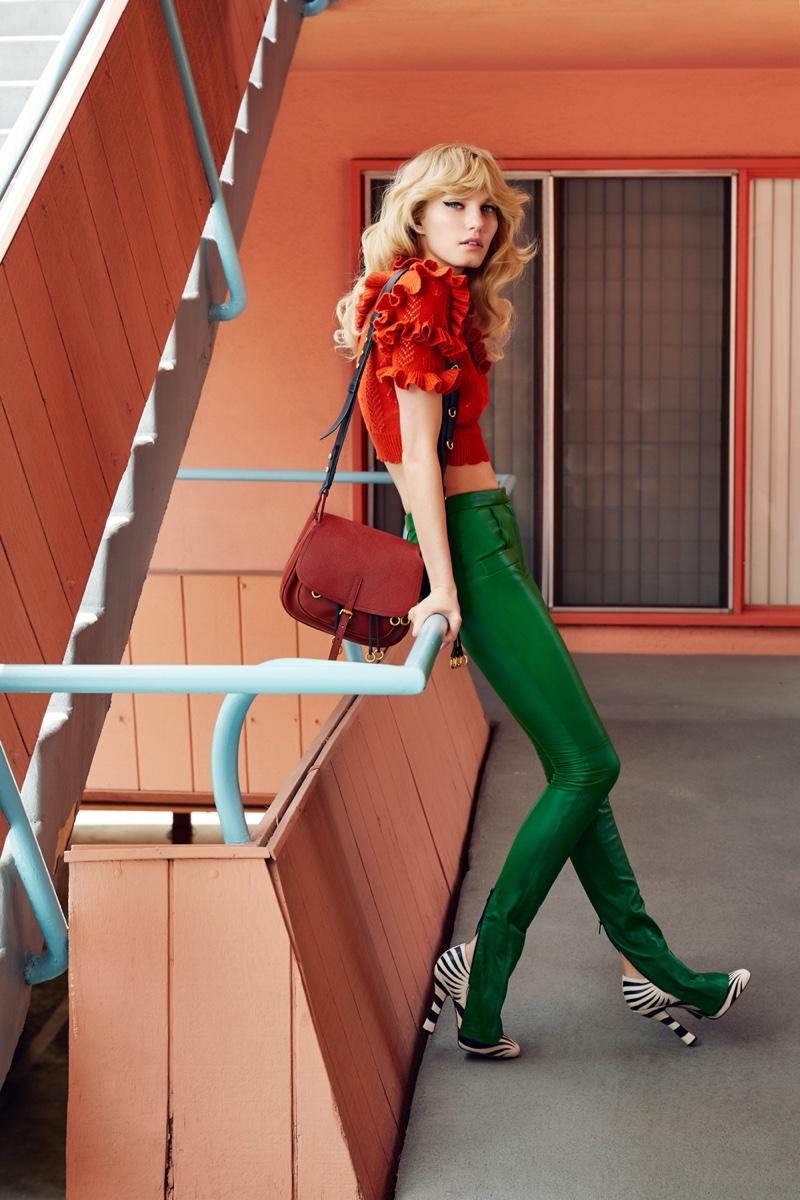Model Marique Schimmel wears Gucci top and heels