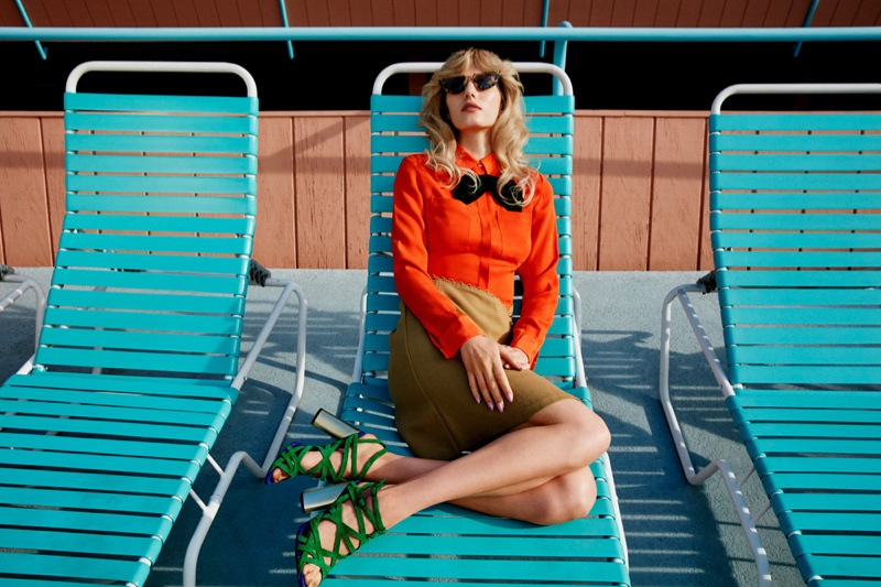 Lounging poolside, Marique Schimmel wears bow-adorned top and pencil skirt