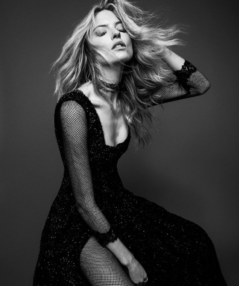 Photographed by black and white, Martha Hunt wears embellished gown