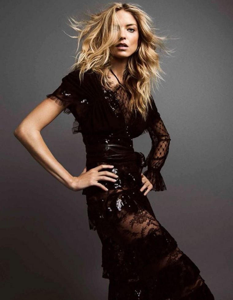 Model Martha Hunt poses in sequins and lace ensemble