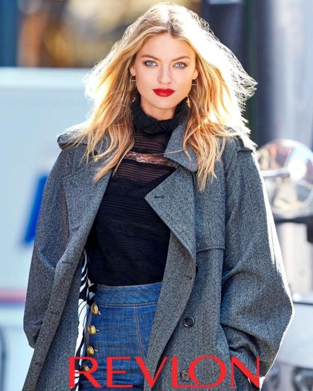 Model Martha Hunt poses in large coat for Revlon shoot