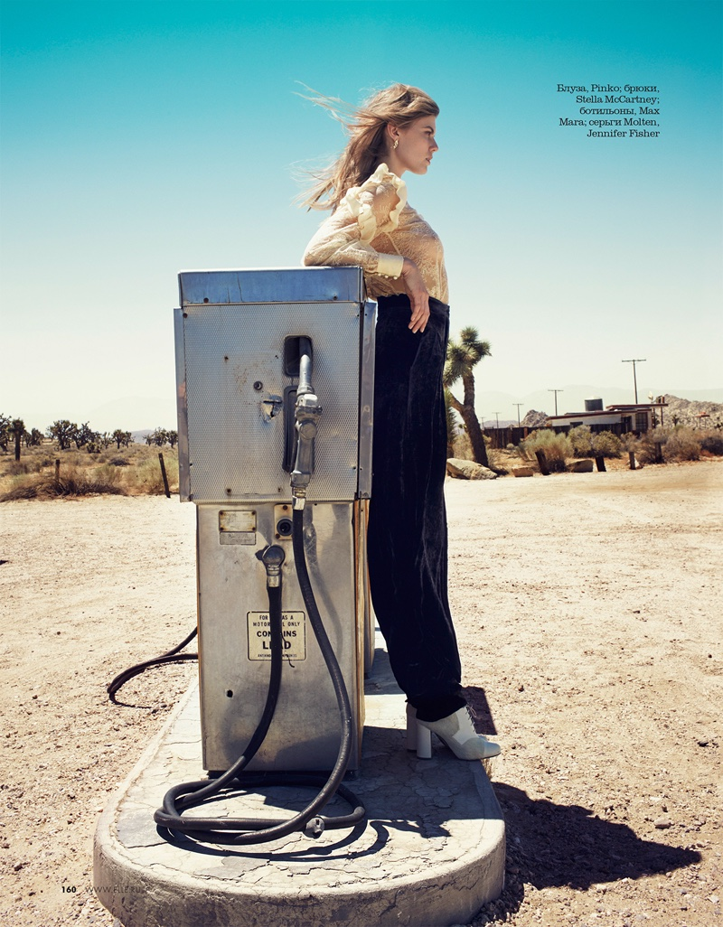 Next to a gas pump, Maryna Linchuk embraces a lace top and pants look