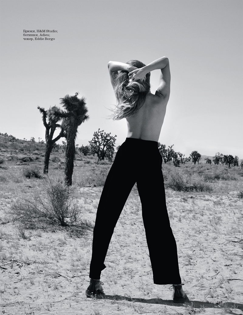 Posing topless, Maryna Linchuk models H&M Studio pants