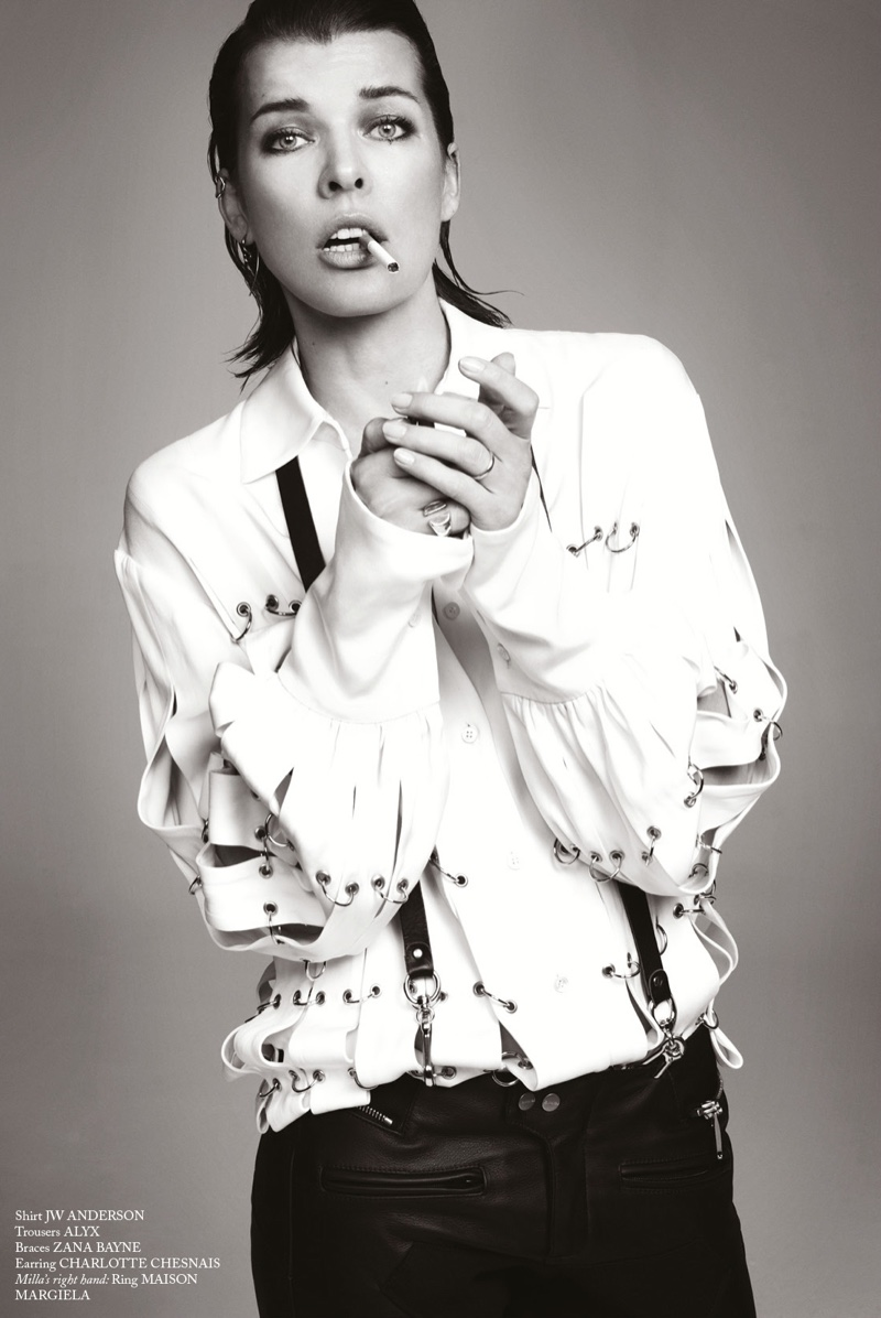 Milla Jovovich has a smoke in JW Anderson shirt and Alyx trousers