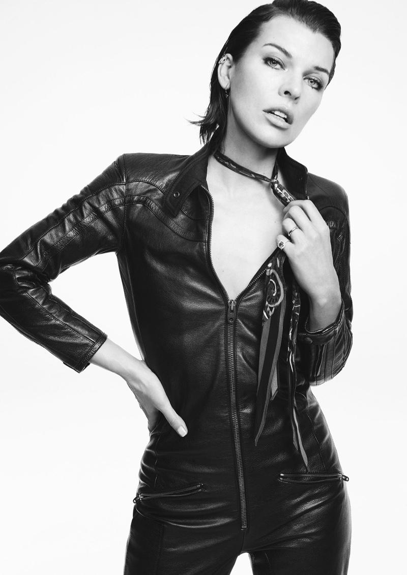 Milla Jovovich wears leather jumpsuit