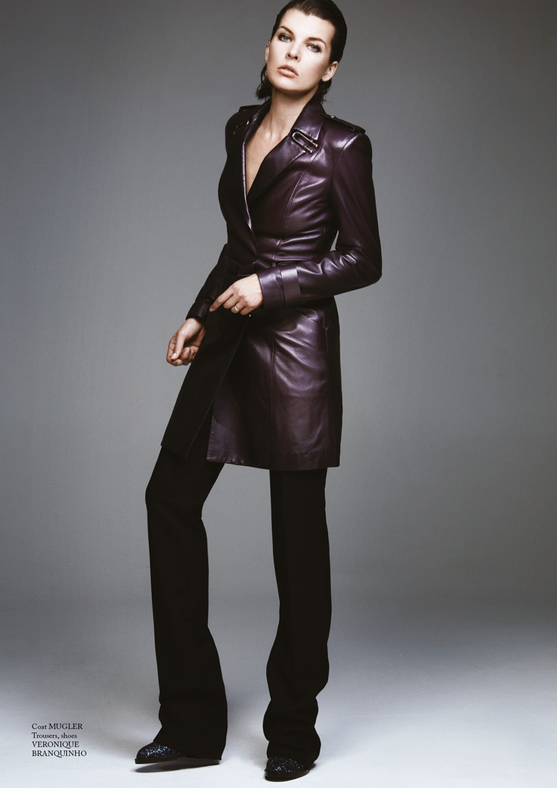 Milla Jovovich models Mugler leather coat with Veronique Branquinho pants and shoes