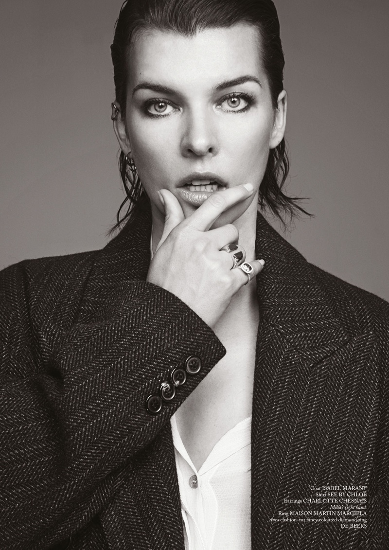 Milla Jovovich wears Isabel Marant Coat with See by Chloe shirt