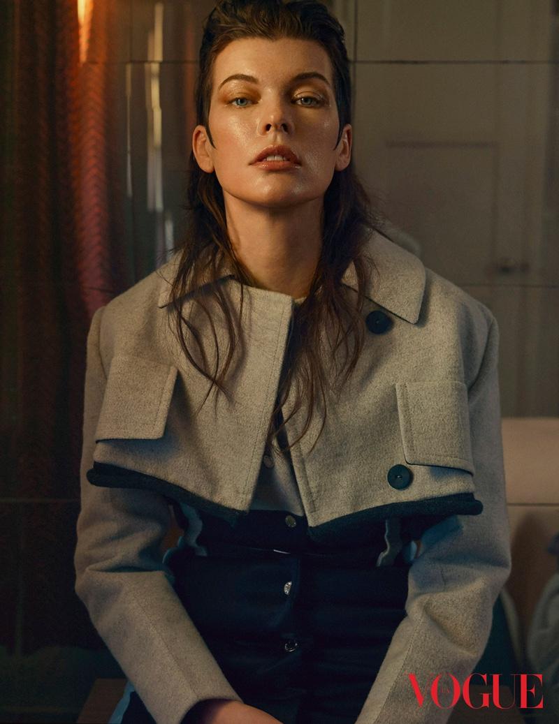 Milla Jovovich poses in Louis Vuitton coat